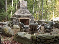 outdoor stone fireplac- in the woods, rustic