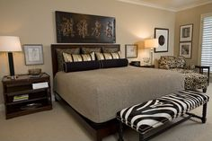 A zebra-print, studded bench is a fun accent piece in this warm-toned bedroom.  Source: http://www.zillow.com/digs/Home-Stratosphere-boards/Luxury-Bedrooms/