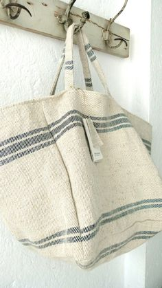 I want this Grain Sack Bag .Shannon Rideout saved to Products I Sack .Totallt in love with anavia Tante SophieI adore toile de jouy fabric, especially in dark blue usually I can only find it in baby blue. Diy Sac, Sack Bag, Grain Sack, Linens And Lace, Linen Bag, Summer Bags, Summer Wear, Summer 2016, Fabric Bags