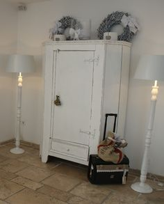 Shabby Chic, prim and rustic....love this cabinet!