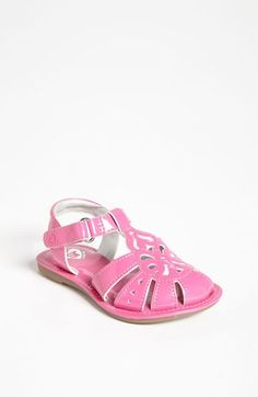 5561b2e0416 A lightweight, metallic sandal is detailed with an intricate design at the  vamp for an