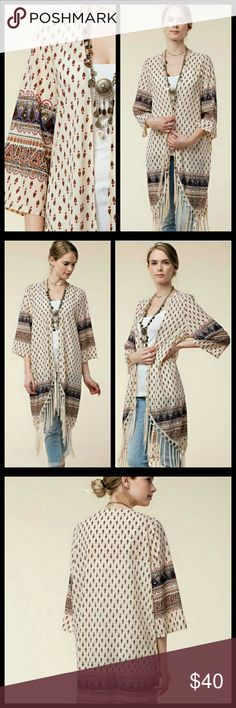 Cream Printed Fringe Kimono Super lightweight material. Silky to the touch.  Material: 55% Cotton 45% Polyester Kori Tops