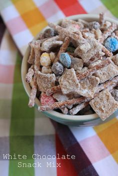 White Chocolate Snack Mix. golden grahams, cocoa puffs, pretzels, nuts and M&M's covered in white chocolate. yum!