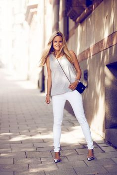 Simple tank and white pants.