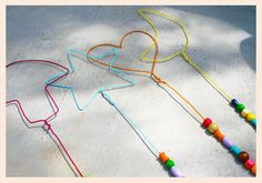 Sandy Toes and Popsicles: Homemade Bubble Wands from wire hangers #upcycle #repurpose