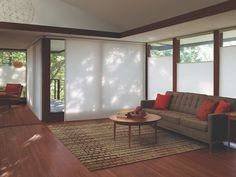 Duette® Architella® honeycomb shades in a living room. Buy at Edgewood Custom Interiors in Weed