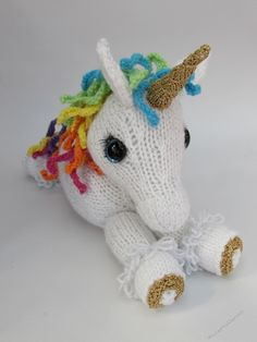 Unicorn Toy Knitting Pattern by Susan Cowper The Unicorn Toy knitting pattern has step by step instructions to make this adorable unicorn toy. Its so cute and perfect for little hands. The unicorn toy can be knitted in any color you choose you could even leave the horn off and knit a pony plush.The toys dimensions are 30cm in length 10.5cm across and 23cm heigh so it is a good sized toy.The patter
