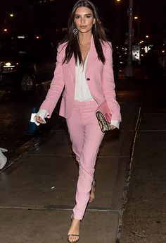 Proving that suits can look fire for a night out is Emily Ratajkowski. Make like the model and style a pastel co-ord over an open white shirt, finishing with a pair of barely there heels and a major clutch. Cute doesn't even cut it