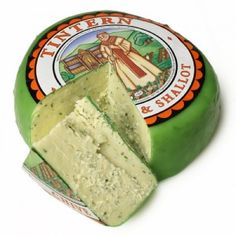 Tintern Cheese, made near Tintern Abbey, Wales is a mild cheddar with chives and shallots. It's amazing!