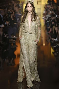 ELIE SAAB Does an amazingly glam and fem pantsuit with a sheen of lace, a train, and a deep plunge with sexy, but ladylike skin. Runway Fashion from Couture Week 2015 - Best of Couture Week 2015