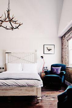 Rustic bedroom with antler chandelier