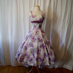 Be still my feminine vintage frock loving heart.  All this, and in lavender?!