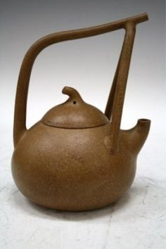 Yixing teapot - emulating the gourd -  traditional Chinese tea pot - I love the graceful nature of it.