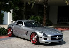 Silver Gray Mercedes Benz SLS with red custom rims