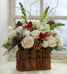 Winter Songbird™ - Roses, Snapdragons, mini Carnations,  finished off with Baby's Breath, Willow Tips and Pinecones