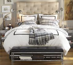 Lorraine Tufted Bed & Headboard | Pottery Barn, white with black hotel bedding, swing arm lamps, bench at foot of bed
