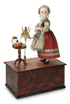 """Sonneberg, likely for the French market, circa 1880.  Lady standing in front of a swift (for winding yarn).  16"""" tall.  Theriaults."""