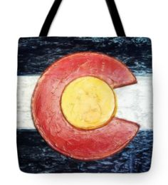 "Colorado Flag Decor Tote Bag, taken from an original plaster wall art piece, by Russell Latino.  Our tote bags are made from soft, durable, poly-poplin fabric and include a 1"" black strap for easy carrying on your shoulder. All seams are double-stitched for added durability. Each tote bag is machine-washable in cold water and is printed on both sides using the same image. Available in 13"" x 13"", 16"" x 16"", and 18"" x 18"". Ships within 2-3 business days."