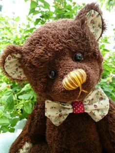 I made him by myself.  His name is  brownie. He is Thai teddy bear.          ( Made by  Kru  Kong.)