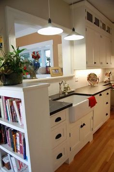 Like the bookshelf on the side - maybe we also extend to include an area to hide the trash bins