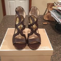 Limited Edition Michael Kors heels Brown, studded, zip back, solid wood heel. Limited edition Michael Kors. Worn once for a photo shoot. Michael Kors Shoes Heels