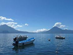 A wild boat ride across Lake Atitlan from the lakeside Maya village of San Pedro la Laguna to Panajachel, Guatemala Lake Atitlan, Boat Covers, Boats, Mountains, Travel, Panajachel, Viajes, Ships, Trips