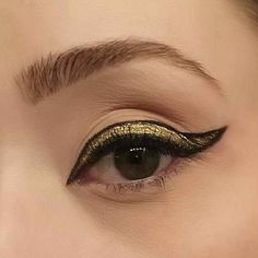 Frame shimmery liner with black. | 23 Ways To Up Your Makeup Game For New Year's Eve