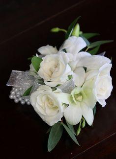 White spray roses & dendrobium orchids