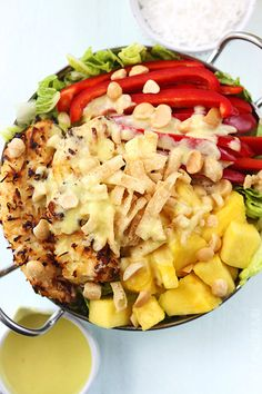 This sensational summer salad has baked coconut chicken tenders, fresh pineapple, macadamia nuts, and a creamy pina colada vinaigrette dressing!