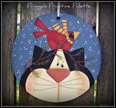 This snowman ornament is painted on a wood circle measuring 6-1/2 across. This is a wonderful size to add to peg hooks or you could also display it in the center of a wreath for your front door. It is light weight allowing it to be displayed just about anywhere in your home, and looks wonderful on your Christmas trees! These would also be a great gift tag to add to packages. I have used a soft winter blue for the background with snow added. It will come ready to hang with a white ribbon...