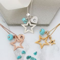 Personalise this gorgeous shiny sterling silver, rose gold or gold  star pendant necklace with her initial and turquoise birthstone charms  to create a unique keepsake gift for her.#jewellery #jewelry #necklace #star t#silver #gold #rosegold #christmas #birthstone #turquoise #december #birthday #personalised #gift #women