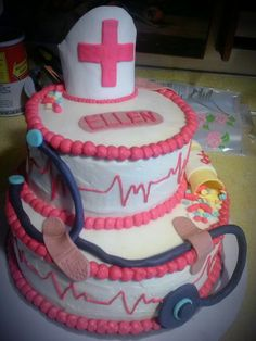 an RN cake I just did 9/25/2013 chocolate & vanilla cake, chocolate mousse filling & cream cheese buttercream filling, vanilla buttercream frosting and marshmellow fondant decorations. I'm open to take orders if anyone needs stuff made :)