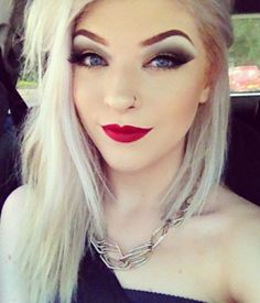 I like her lip color... and her eye makeup... and eyebrows... and hair... and nose ring... and face.