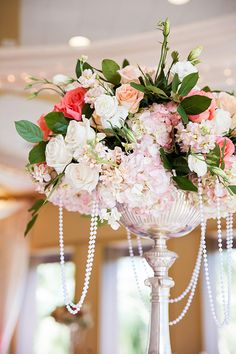 Blush pink hydrangea centerpiece with pastel roses and pearls