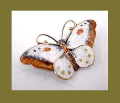 Google Image Result for http://www.jltimelessjewelry.com/images/prydz-enamel-butterfly-pin-1589.jpg