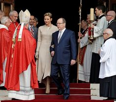 Prince Albert and Princess Charlene of Monaco leave the Monaco Cathedral during the Sainte Devote festivities in Monaco.