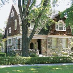 Stone & brown shingle siding - A Dutch Colonial Revival house in Detroit's The Villages neighborhood.