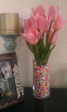 $3 Valentine centerpiece. You can find bag of candy hearts, vase, and flowers all at Dollar Tree for a cute center piece.