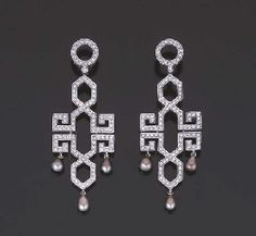 """PAIR OF EARRINGS PENDANTS PEARLS AND DIAMONDS A decor motifs """"Chinese"""" set with small diamonds, each holding three cultured pearls pendants, white gold mount."""