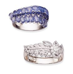 A SAPPHIRE AND DIAMOND BRACELET AND A DIAMOND BRACELET, BY CARTIER.  The first, set with a central cushion-shaped pale blue sapphire tapered scroll, enhanced by circular-cut diamonds, with a central calibré-cut sapphire ribbon, to the hinged polished band; and the second, set with a central flower, with circular-cut diamond open petals with baguette-cut diamond stem and pavé-set diamond leaves to the hinged tapered band, circa 1938.  The first signed Cartier, the second Monture Cartier