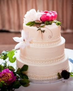 A light lemon cake by One Girl Cookies was piped with buttercream and accented with fresh flowers.