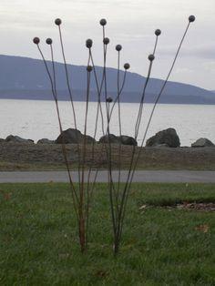 steel ball weeds garden art