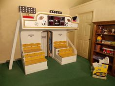 """Playhouse Features: Two """"locker room"""" cupboards; electronic scoreboard; stadium seating; light stations"""