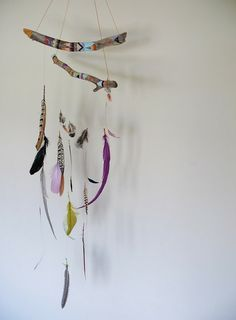 Cute and easy....painted sticks, string, and feathers