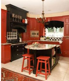 JULIE   More Red Cabinets Bold, Beautiful Red Kitchen Cabinets Look  Polished And Pretty When Paired With Black. THIS SITE Has Amazing Ideas!