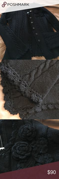 Extra Fine Black Merino Cardigan Swearer Warm, beautifully made wit amazing accents on belled cuffs, collar, and bottom. Woven flowers on right side. I bought one & got one as gift. The will is so fine you will need a lint roller regularly, but Sweater is worth the trouble. Looks good ANYWHERE. NWT Saks 5th Avenue Sweaters Cardigans