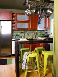 Clever storage space and a wall-mounted bar give this small kitchen function and style.  Love this space? Steal the look.