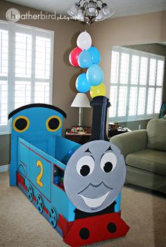Thomas the Train Birthday Party -- painted train cars with his name (cake topper?)