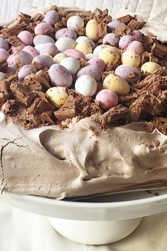Chocolate pavlova topped with cream and mini eggs