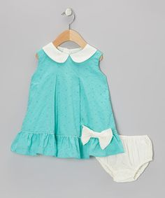 Because a charming frock is customary in every girl's closet, this dress features adorable eyelet fabric and a precious Peter Pan collar. Buttons in back and a matching diaper cover marry comfort with class.